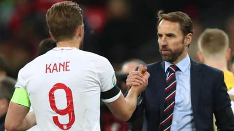 England captain Harry Kane (left) and manager Gareth Southgate (right) shake hands after a match