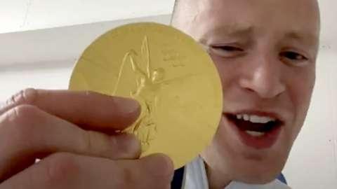 Swimmer Adam Peaty flashing his gold on TikTok