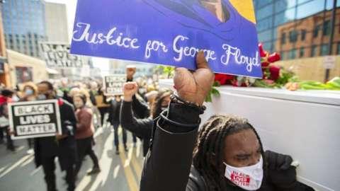 People rallying in Minneapolis ahead of the George Floyd trial