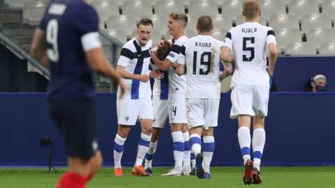 Finland's players celebrate scoring against France in a friendly in Paris