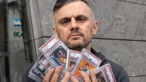 Gary Vaynerchuk holds a collection of his sports card collection