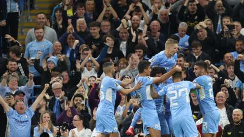 Manchester City celebrate scoring a goal against RB Leipzig