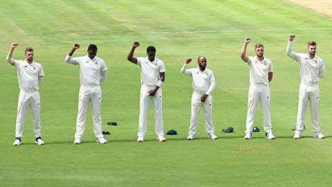 South Africa's cricketers raise their right fists in an anti-racism gesture before the first Test against Sri Lanka