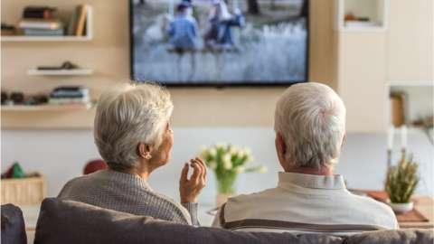 Elderly couple watching TV