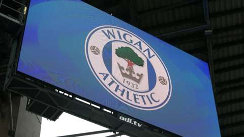 Wigan Athletic crest on a big screen