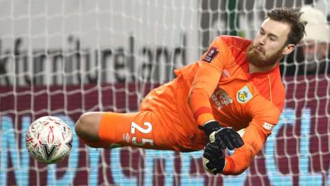 Burnley keeper Will Norris saves in the penalty shootout