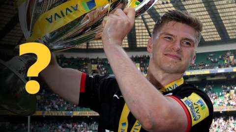 Owen Farrell holds the Premiership trophy