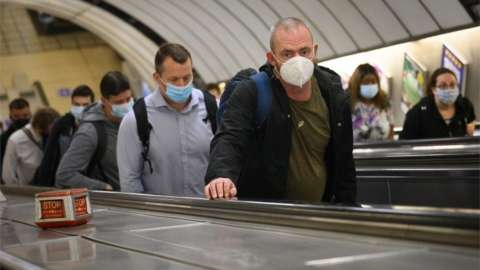 Commuters on the Tube wearing a face covering