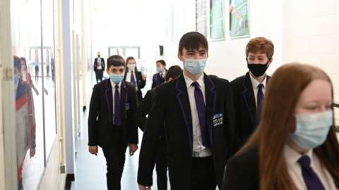 A Year 9 class walk along a corridoor at Park Lane Academy in Halifax, northwest England on March 4, 2021.