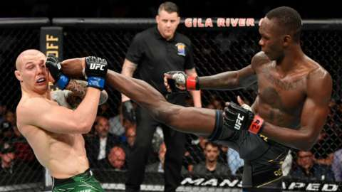 Israel Adesanya of Nigeria kicks Marvin Vettori of Italy in their UFC middleweight championship fight during the UFC 263 event at Gila River Arena in Glendale, Arizona