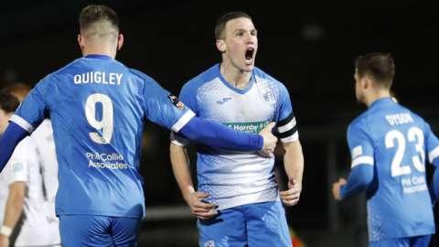 John Rooney scores a goal for Barrow