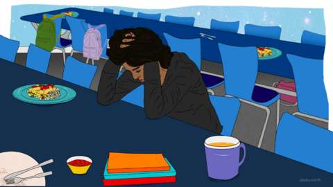 Animation of student sitting at table with head in hands