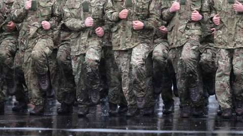 Troops training in the rain