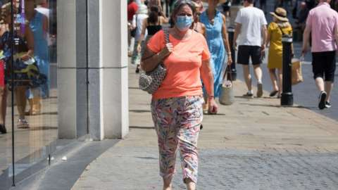 Woman wears a face covering in Windsor