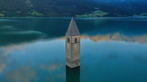 An aerial picture shows the bell tower in Lake Resia