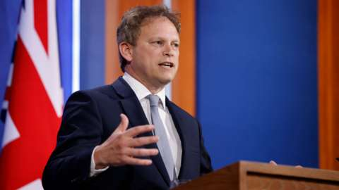 Britain's Transport Secretary Grant Shapps gives a virtual press conference inside the new Downing Street Briefing Room in central London on May 7, 2021.