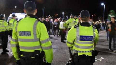 Police patrol outside a football stadium