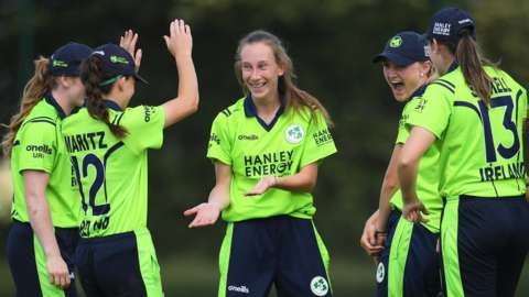 Ireland celebrate a wicket by Orla Prendergast