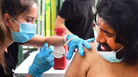 A man being vaccinated