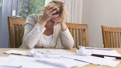 A woman going through her finances