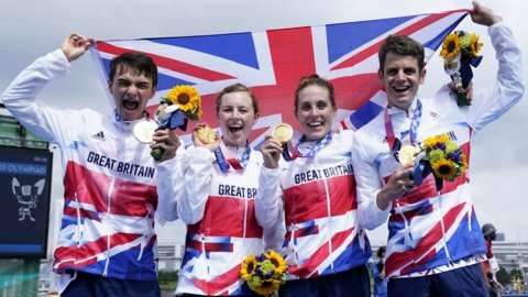 Great Britain celebrate winning the inaugural triathlon mixed relay event at an Olympic Games
