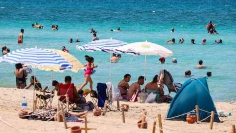 People on the beach at Izmir, Turkey