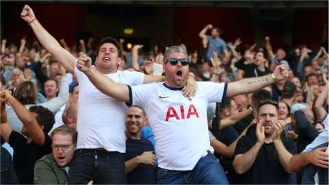 Tottenham fans celebrate a goal