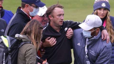 Actor Tom Felton receives medical attention after collapsing during the celebrity matches ahead of the 43rd Ryder Cup at Whistling Straits