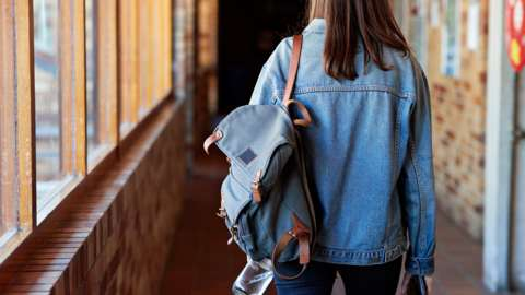 Student walking with backpack