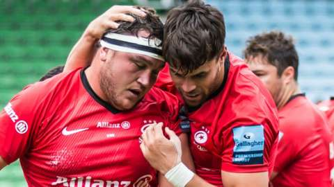 Jamie George (left) scores a try for Saracens