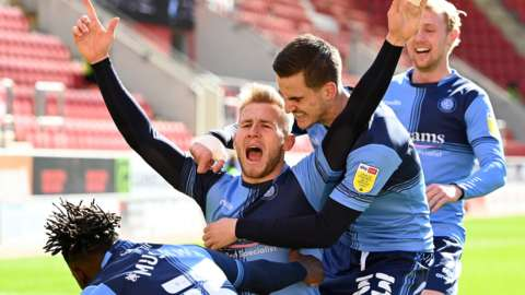Jason McCarthy celebrates his goal for Wycombe against Rotherham