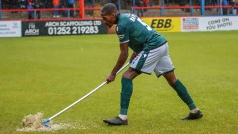 Mopping up Aldershot's pitch