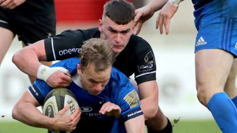 Ulster A's Ben Moxham tackles Leinster A's Niall Comerford at Kingspan Stadium