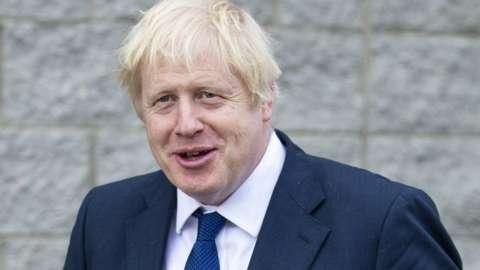 Britain's Prime Minister Boris Johnson leaves after visiting Peterhead Fish Market in Peterhead,