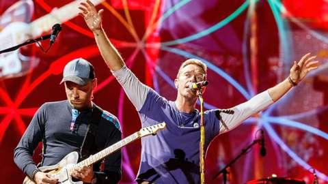 Coldplay's Jonny Buckland and Chris Martin performing in Vancouver in 2017