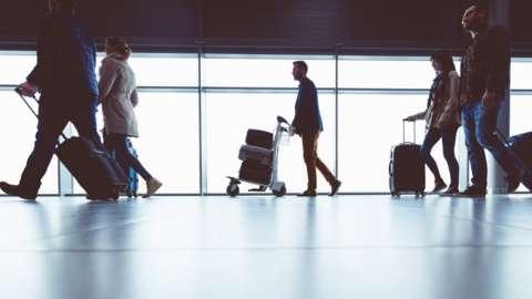 People walking through airport