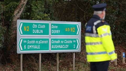 Garda stop vehicles at a checkpoint on the Irish border between Emyvale and Aughnacloy on 8 February 2021