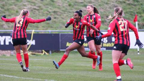 Lewes FC players celebrate a goal