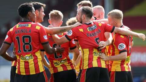 Partick thistle players celebrate Kevin Holt's opening goal