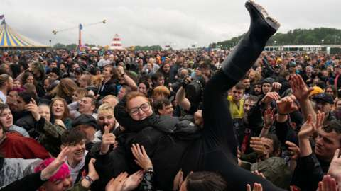 A festivalgoer crowd surfs on the first day of Download Festival