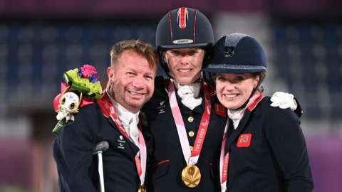 Lee Pearson, Sophie Wells and Natasha Baker celebrate team gold