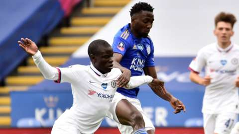Leicester's Wilfred Ndidi (right) tackles Chelsea's N'Golo Kante