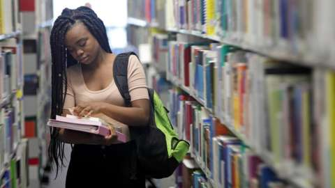 A female student at the library