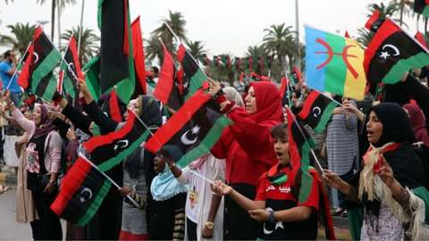 A group of people attend a celebration rally on the fourth anniversary of Gaddafi's death at the es- Suheda square in Tripoli, Libya on 20 October 2015