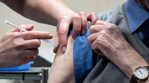 Ralph Evans receiving the Oxford vaccine in Merthyr Tydfil
