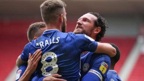 Sean Morrison celebrates goal with hug of team-mates