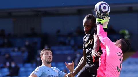 West Ham's Michail Antonio challenges for a header with Manchester City's Ederson