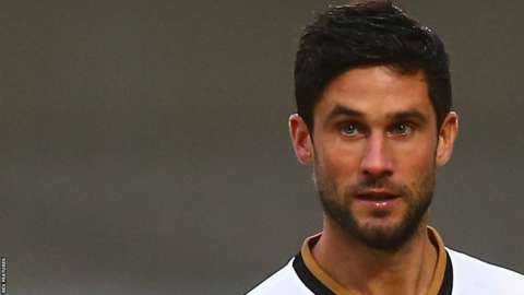 Andrew Surman in action for MK Dons