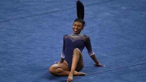 UCLA Bruins gymnast Nia Dennis competes in the floor exercise against the Arizona State Wildcats during the season opener in Pauley Pavilion on the campus of UCLA in Los Angeles on Saturday, January 23, 2021.