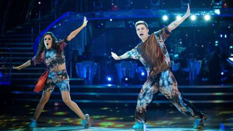Janette Manrara and HRVY dancing on stage